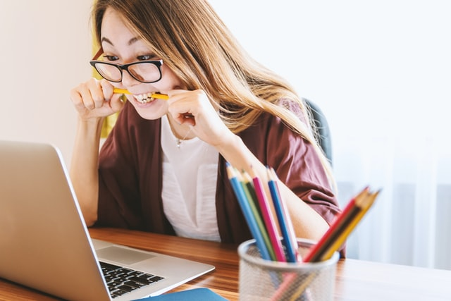 Young woman biting her pencil (most likely out of frustration). I bet she wants to increase her productivity.